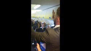 Man performs hilarious cross dressing stag do prank on Ryanair flight - Video