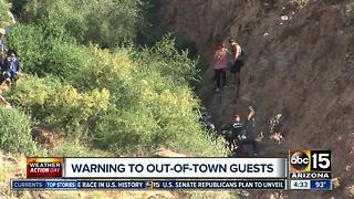 Park rangers warning hikers during Phoenix heat - Video