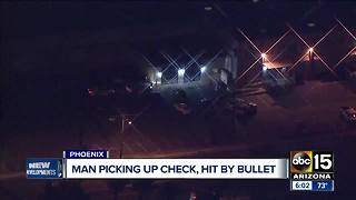 Man shot in Phoenix while picking up a check - Video
