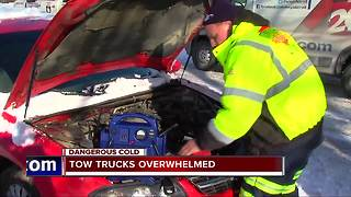 Tow truck drivers overwhelmed by problems in cold weather - Video