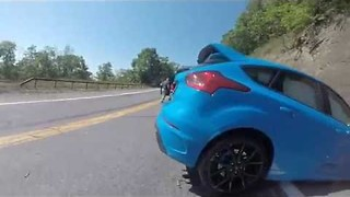 Car Attempting to Drift Around Hairpin Turn Crashes Into Wall - Video