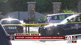 Woman faces charges after son found dead - Video