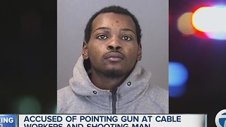 Man accused of pointing gun a cable worker and shooting man - Video