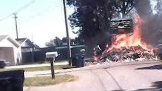 Truck catches fire, dumps debris on parked cars - Video