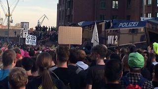 G20 Protesters March Through Hamburg - Video