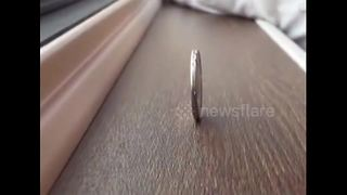 Coin balance test on China's first domestically-built bullet train - Video