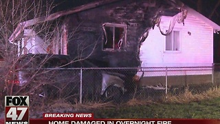 Home damaged in overnight fire in Lansing - Video