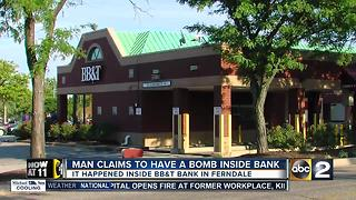 Man claims to have bomb inside bank - Video