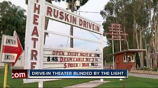 Lights shining from new development hurting drive-in business - Video