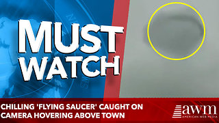 Chilling 'flying saucer' caught on camera hovering above town - Video