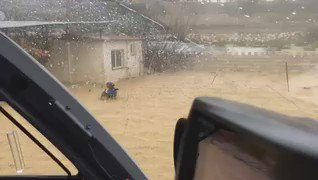 Man and Dog Caught in Malaga Flooding Airflifted to Safety - Video