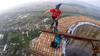 Daredevil Unicyclist Performs On Top of Giant Chimney - Video