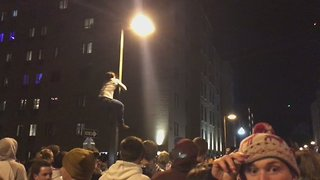 Students Climb Lamp Posts During Penn State Celebrations