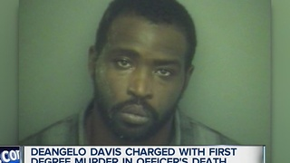 Davis charged with officer's murder - Video