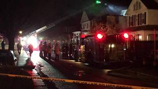 4 injured, 6 children missing in northeast Baltimore house fire - Video