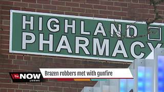 Would-be robber shot by store owner at Akron pharmacy - Video