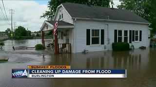 Homeowners cleaning up after flash floods