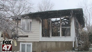 Smoke alarm saves woman from house fire