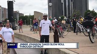 NASCAR champ Jimmie Johnson rides his bike through Detroit for the slow roll - Video