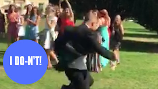 Hilarious footage shows man doing a runner after his girlfriend catches bride's bouquet