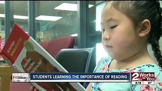 Students learning the importance of reading
