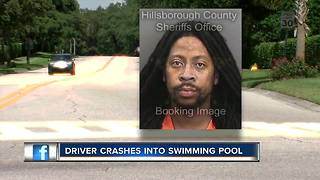 Driver crashes into swimming pool - Video