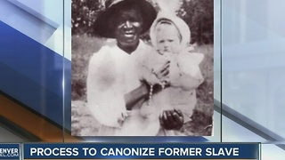 Process to canonize former slave - Video