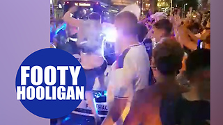 Football hooligan jumps on top of police car during England World Cup celebrations - Video