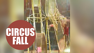 Circus performer narrowly dodges death after falling 30ft from giant spinning wheel - Video