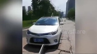 Chinese couple escape injury after broken water pipe impales car