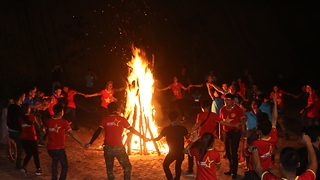 Wonderful dancing around big fire in the forest