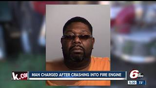Man charged after crashing into Indianapolis fire truck - Video