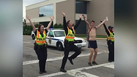 Police Officers Start YMCA Flash Mob