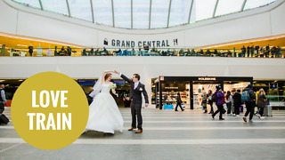 Newlywed couple pose for their marriage photos at train station - Video