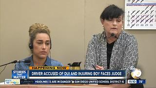 Driver accused of DUI and injuring boy faces judge - Video