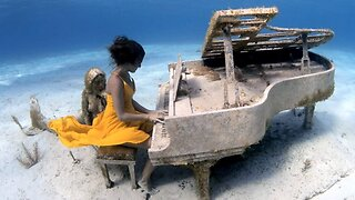 Breathtaking Images Of Free Diver Playing Underwater Piano