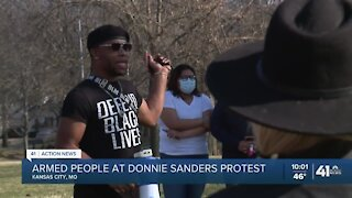 Armed people at Donnie Sanders protest