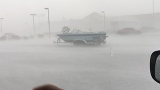 VIDEO: Strong winds push boat across parking lot