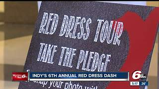 Women and men in red made their way around Monument Circle to raise awareness about women's heart health - Video