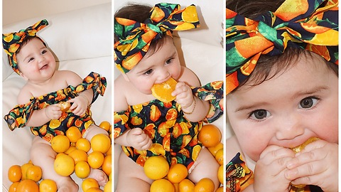 Baby in orange-themed dress eats oranges for the first time