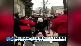 New Jersey teacher attacked trying to break up brawl - Video