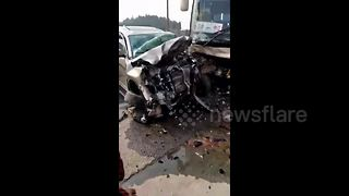 SUV crashes head-on into coach in China - Video