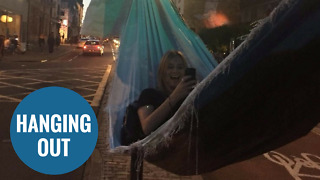 Revellers use two traffic lights to build makeshift HAMMOCK