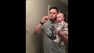 Baby has hilarious reaction to her dad brushing his teeth