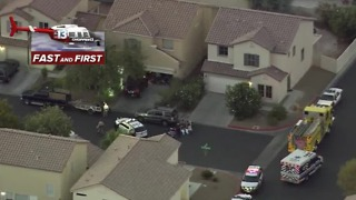 Police surround neighborhood near Sahara, Sloan - Video