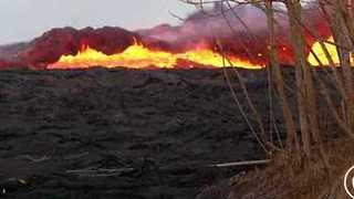 Lava from Volcanic Fissure Surges Across Hawaii Landscape - Video
