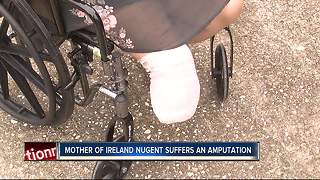 Mother of girl who lost both legs in lawn mowing accident undergoes own amputation - Video