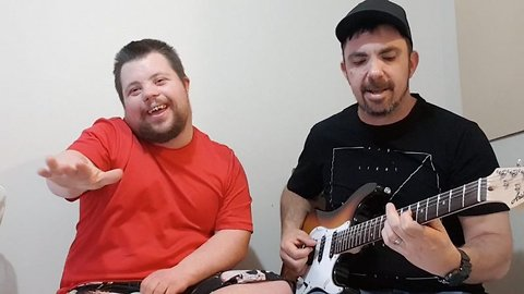 Music teacher forms viral bond by performing well-known hits with down syndrome pupil