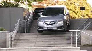 Driver takes shortcut down flight of stairs