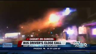 Bus driver's close-call as car launches into building - Video